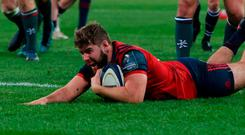 Munster's Rhys Marshall goes over to score a try during their impressive Champions Cup victory. Photo: Niall Carson/PA Wire