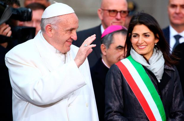 Pope Francis waves next to Rome's mayor Virginia Raggi as he arrives to lead the Immaculate Conception celebration prayer in Piazza di Spagna in downtown Rome, Italy. Photo: REUTERS/Alessandro Bianchi