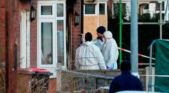 Forensic officers at the scene of the fatal house fire in Manchester. Photo credit: Peter Byrne/PA Wire