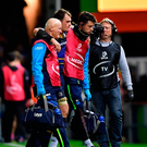 Rhys Ruddock of Leinster leaves the pitch with an injury during the European Rugby Champions Cup Pool 3 Round 3 match between Exeter Chiefs and Leinster at Sandy Park