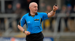 Referee Martin Higgins has slammed the behaviour of 'some officials and managers'