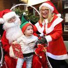 Santa and his Elves, Harry Potter, Trolls, Beauty and the Beast transform Our Lady's Children's Hospital, Crumlin into a magical fantasy land on their Annual Ho Ho Day. Pictured is two and a half-year-old Oliver Jalowiecki from Galway pictured with Santa Claus (Gerry Cully) from CMRF and Mrs. Claus (Pauline Robinson) from Our Lady's Children's Hospital, Crumlin. PHOTO: Mark Stedman