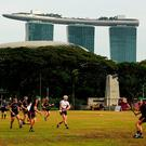 The Marina Bay Sands Hotel overshadows the action during All Star Tour 2017 hurling game at the Singapore Recreation Club. Photo: RAY McMANUS/SPORTSFILE