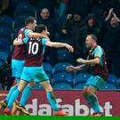 Burnley's English striker Ashley Barnes (2L) celebrates after scoring during the English Premier League football match between Burnley and Stoke at Turf Moor in Burnley, north west England on December 12, 2017. / AFP PHOTO / Paul ELLIS