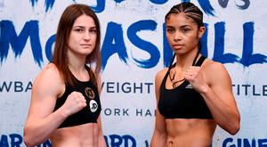 Katie Taylor with Jessica McCaskill at yesterday's weigh-in. Photo: SPORTSFILE