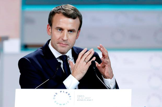 French President Emmanuel Macron delivers the closing speech the Plenary Session of the One Planet Summit at the Seine Musicale event site on the Ile Seguin in Boulogne-Billancourt, near Paris, France, December 12, 2017. REUTERS/Etienne Laurent/Pool