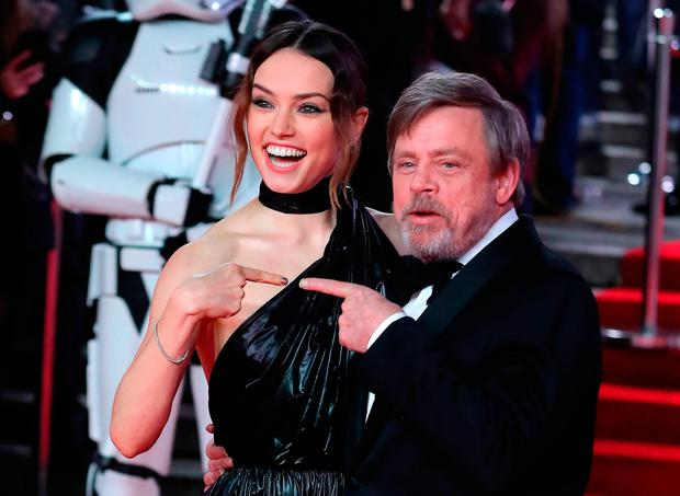 English actress Daisy Ridley (L) and US actor Mark Hamil pose on the red carpet for the European Premiere of Star Wars: The Last Jedi at the Royal Albert Hall in London on December 12, 2017. / AFP PHOTO / Daniel LEAL-OLIVASDANIEL LEAL-OLIVAS/AFP/Getty Images