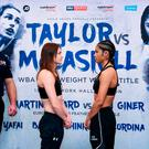 Katie Taylor, left, and Jessica McCaskill square off after weighing in at the Courthouse Hotel in Shoreditch, London, ahead of their WBA Lightweight World Title fight. Photo by Stephen McCarthy/Sportsfile