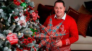 Neven Maguire with jumper, tree and decorations - all from Dunnes Stores. Photo: Fran Veale