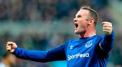 Everton's Wayne Rooney celebrates scoring his side's first goal of the game during the Premier League match at St James' Park, Newcastle. Photo credit should read: Owen Humphreys/PA Wire.