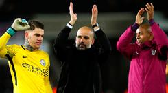 Soccer Football - Premier League - Swansea City vs Manchester City - Liberty Stadium, Swansea, Britain - December 13, 2017 Manchester City manager Pep Guardiola and Fernandinho applaud the fans at the end of the match as Ederson celebrates Action Images via Reuters/Andrew Boyers