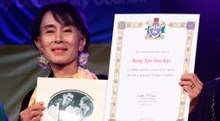 Aung San Suu Kyi gets the freedom of the city at the Bord Gáis Theatre in 2012. Photo: Collins