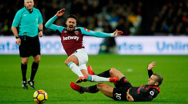 Arsenal's Jack Wilshere in action with West Ham United's Manuel Lanzini. Photo: David Klein/Reuters