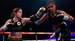 Katie Taylor lands a left hand on Jessica McCaskill during their WBA Lightweight World title fight at York Hall in London last night. Photo: Sportsfile