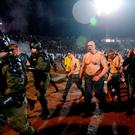 Policemen escort fans away from trouble between Partizan Belgrade and Red Star Belgrade