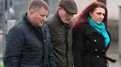 Leader of Britain First, Paul Golding (left) with Deputy leader Jayda Fransen (right) arriving at Belfast Laganside courts where she faces charges on an alleged hate speech that took place in Belfast in August. Photo: Mark Marlow/PA Wire