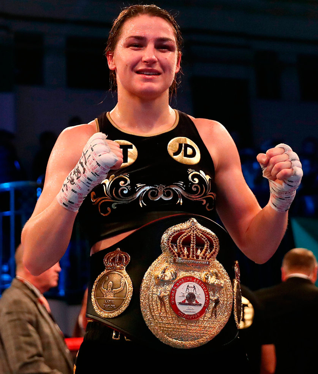 Katie Taylor celebrates with her belt after defeating Jessica McCaskill in her WBA lightweight world championship title defence. Photo: Tim Goode/PA