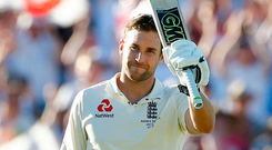 England's Dawid Malan celebrates his century during day one of the Ashes Test match in Perth. Photo: Jason O'Brien/PA
