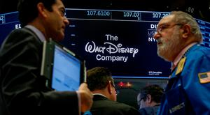 Traders work at the post where Walt Disney stock is traded on the floor of the New York Stock Exchange (NYSE)