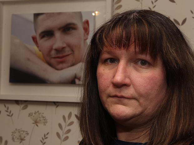 Julie Patton at her home in Drunkeen, Co Donegal with a portrait of her late son Shane who was killed by a drunk driver in 2012. Photo Brian McDaid