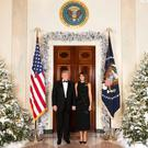 Donald and Melanie's Christmas card is missing one significant element.... PIC: The White House