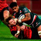 Valentino Mapapalangi of Leicester Tigers is tackled by Chris Cloete of Munster during the European Rugby Champions Cup Pool 4 Round 3 match between Munster and Leicester Tigers at Thomond Park in Limerick. Photo by Diarmuid Greene/Sportsfile