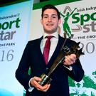Paul O'Donovan with last year's trophy. Photo by David Maher/Sportsfile