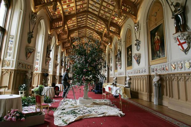 WINDSOR, UNITED KINGDOM: Flowers are arranged in St George's Hall in Windsor Castle 08 April, 2005, for the reception after the royal wedding on Saturday between the Prince of Wales and Camilla Parker Bowles. EMBARGOED: Not for publication before 0001 Saturday 09 April, 2005. AFP PHOTO / Kirsty Wigglesworth / WPA Rota / PA (Photo credit should read KIRSTY WIGGLESWORTH/AFP/Getty Images)