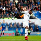 Crystal Palace's Christian Benteke fouls Leicester City's Kasper Schmeichel