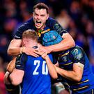 James Ryan of Leinster celebrates with team-mates Dan Leavy, Scott Fardy and try scorer Luke McGrath after their side's first try during the European Rugby Champions Cup Pool 3 Round 4 match between Leinster and Exeter Chiefs at the Aviva Stadium in Dublin. Photo by Brendan Moran/Sportsfile