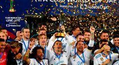 Soccer Football - FIFA Club World Cup Final - Real Madrid vs Gremio FBPA - Zayed Sports City Stadium, Abu Dhabi, United Arab Emirates - December 16, 2017 Real Madrid's Cristiano Ronaldo and team mates celebrate with the trophy after winning the FIFA Club World Cup REUTERS/Amr Abdallah Dalsh