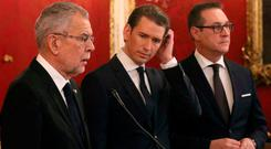 Meeting: Austrian President Alexander Van der Bellen, left, foreign minister and leader of the OVP, Sebastian Kurz, and Heinz-Christian Strache, of the Freedom Party, yesterday. Photo: AP