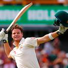 Australia's captain Steve Smith celebrates reaching his double century during the third day of the third Ashes test. Photo: David Gray/Reuters