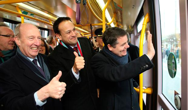 Birth of a new era: Luas Cross City opens for passengers, with Shane Ross, Leo Varadkar and Paschal Donohoe. Photo: Julien Behal Photography