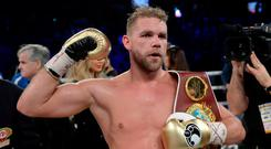 Billy Joe Saunders, of Britain, celebrates his win over David Lemieux, of Canada, to retain the WBO middleweight boxing title in Laval, Quebec, Saturday, Dec. 16, 2017. (Ryan Remiorz/The Canadian Press via AP)