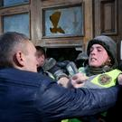 Supporters of former Georgian President and Ukrainian opposition figure Mikheil Saakashvili clash with police as they try to break into the building of the International Art Centre in Kiev, Ukraine, December 17, 2017. REUTERS/Valentyn Ogirenko