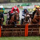 My Tent Or Yours, with Barry Geraghty up (ledt), clears the last on the way to winning The Unibet International Hurdle from The New One (red) at Cheltenham. Photo: Alan Crowhurst/Getty Images