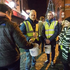 Vincent Hogan, hurler Peter Kelly and camogie player Anna Geary collecting money on Saturday night in Dublin. Photo: Fergal Phillips