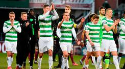 Captain Scott Brown leads the way as Celtic's shell-shocked players applaud their supporters after their defeat at Tynecastle Photo: Ian Rutherford/PA Wire