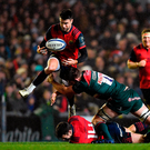 Conor Murray is tackled by Michael Fitzgerald during yesterday's match at Welford Road Photo: Brendan Moran/Sportsfile