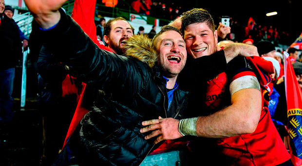 Jack O'Donoghue celebrates with Munster supporter Patrick Dowling after the match Photo: Brendan Moran/Sportsfile