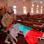 Security personnel remove the body of a victim after suicide bombers attacked a Methodist church in Quetta Photo: CALVIN/AFP/Getty Images