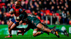 Munster's Simon Zebo is tackled by Valentino Mapapalangi and Mike Williams of Leicester Photo: Brendan Moran/Sportsfile