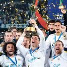 Real Madrid's Cristiano Ronaldo holds the trophy after winning the Club World Cup final