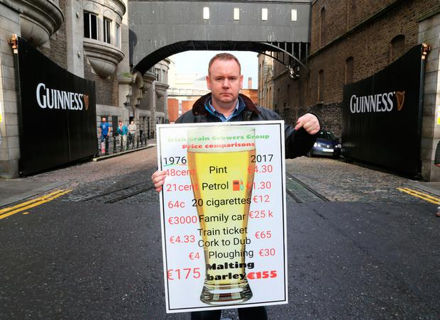 Bobby Miller, chairman of the Irish Grain Growers Group, makes his point at a previous protest at the Guinness Hop Store in Dublin. Photo: Colin O'Riordan