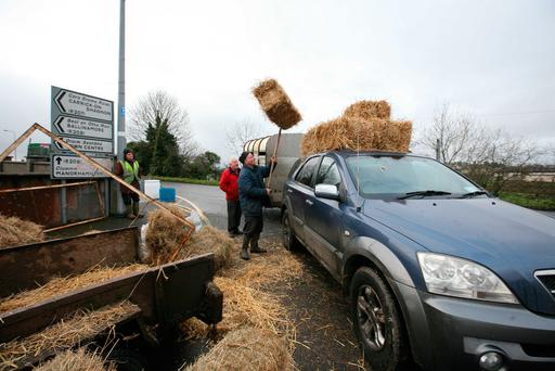 Farmers stocking up on fodder at the Drumshanbo Horse Fair, Co Leitrim. Photo Brian Farrell