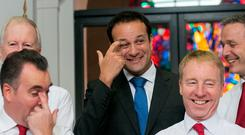 Taoiseach Leo Varadkar with the department's staff choir for the annual lunchtime recital of Christmas carols at Government Buildings, Dublin. Photo: Gareth Chaney