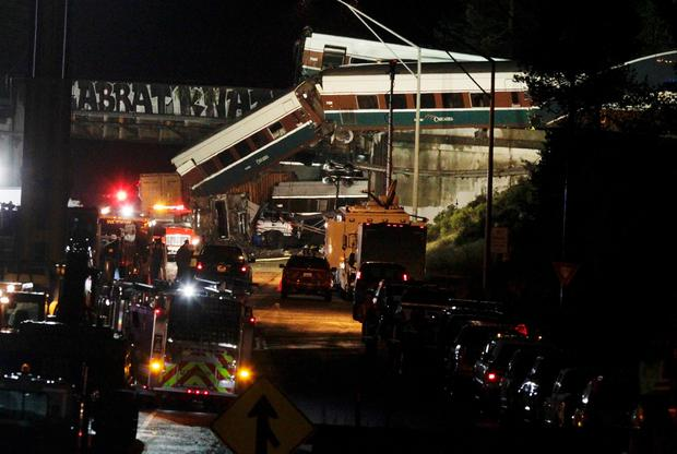 The scene where an Amtrak passenger train derailed on a bridge over interstate highway I-5 in DuPont, Washington, U.S. December 18, 2017. REUTERS/Steve Dipaola TPX IMAGES OF THE DAY