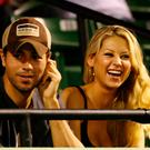 Enrique Iglesias and girlfriend Anna Kournikova watch as Venus Williams plays her semifinal match against Serena Williams at the Sony Ericsson Open at the Crandon Park Tennis Center on April 2, 2009 in Key Biscayne, Florida. (Photo by Al Bello/Getty Images)