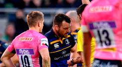 Cian Healy of Leinster receives a yellow card from Referee Pascal Gauzere against Exeter